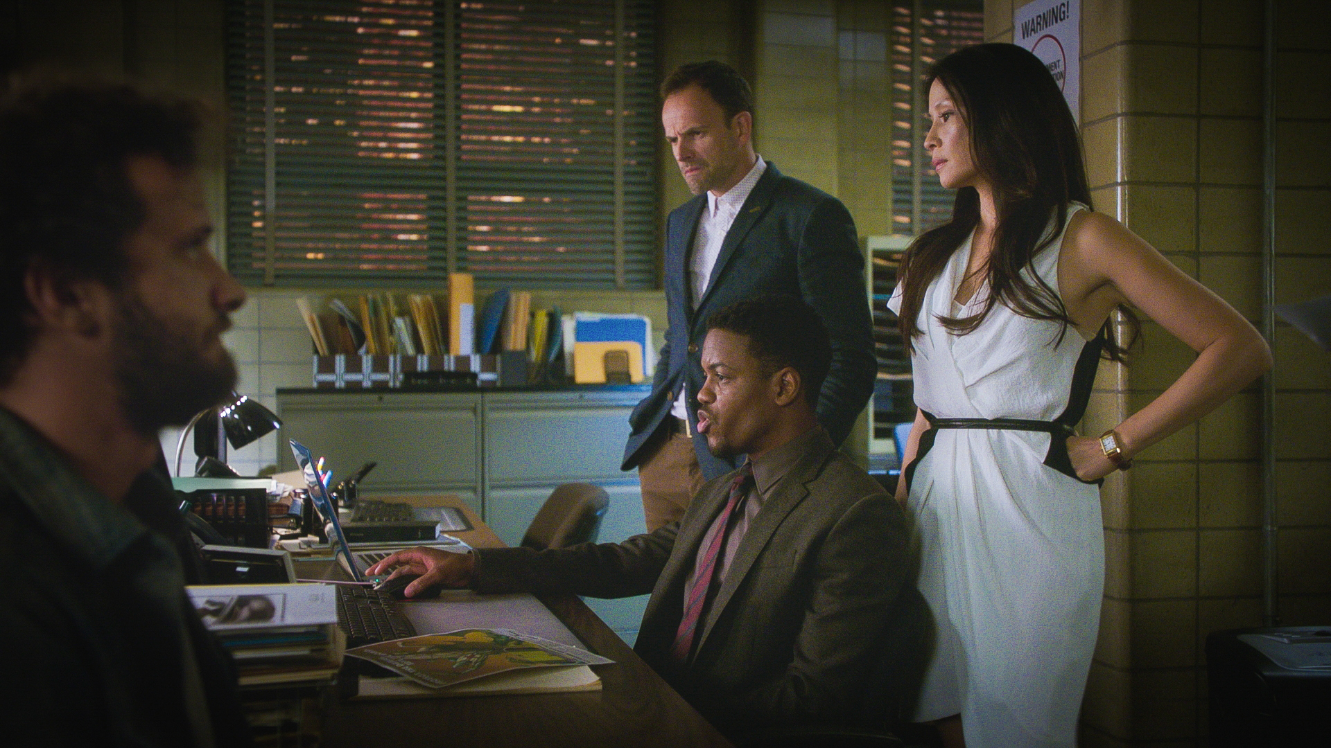 Jon Michael Hill as Detective Marcus Bell, Jonny Lee Miller as Sherlock Holmes, and Lucy Liu as Dr. Joan Watson
