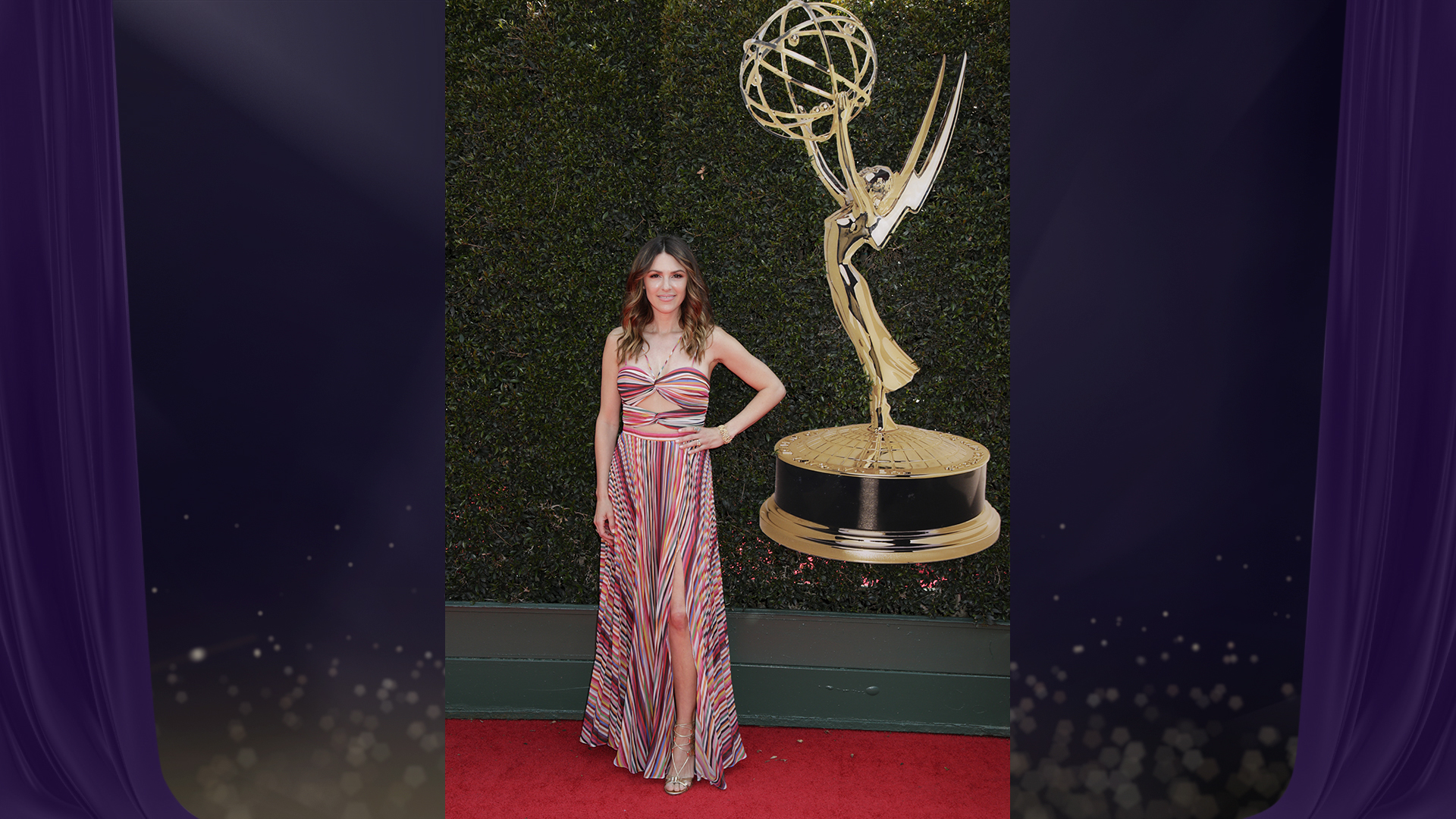 Elizabeth Hendrickson, who's nominated for Outstanding Supporting Actress in a Drama Series for her work on The Young and the Restless, shows some leg in her striped halter dress with cut-outs.