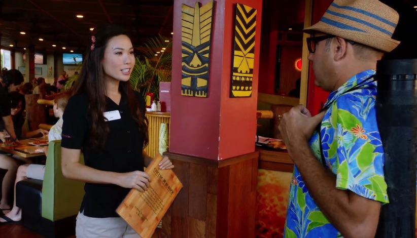 Emma Wo, who plays the hostess, is a former Miss Hawaii.