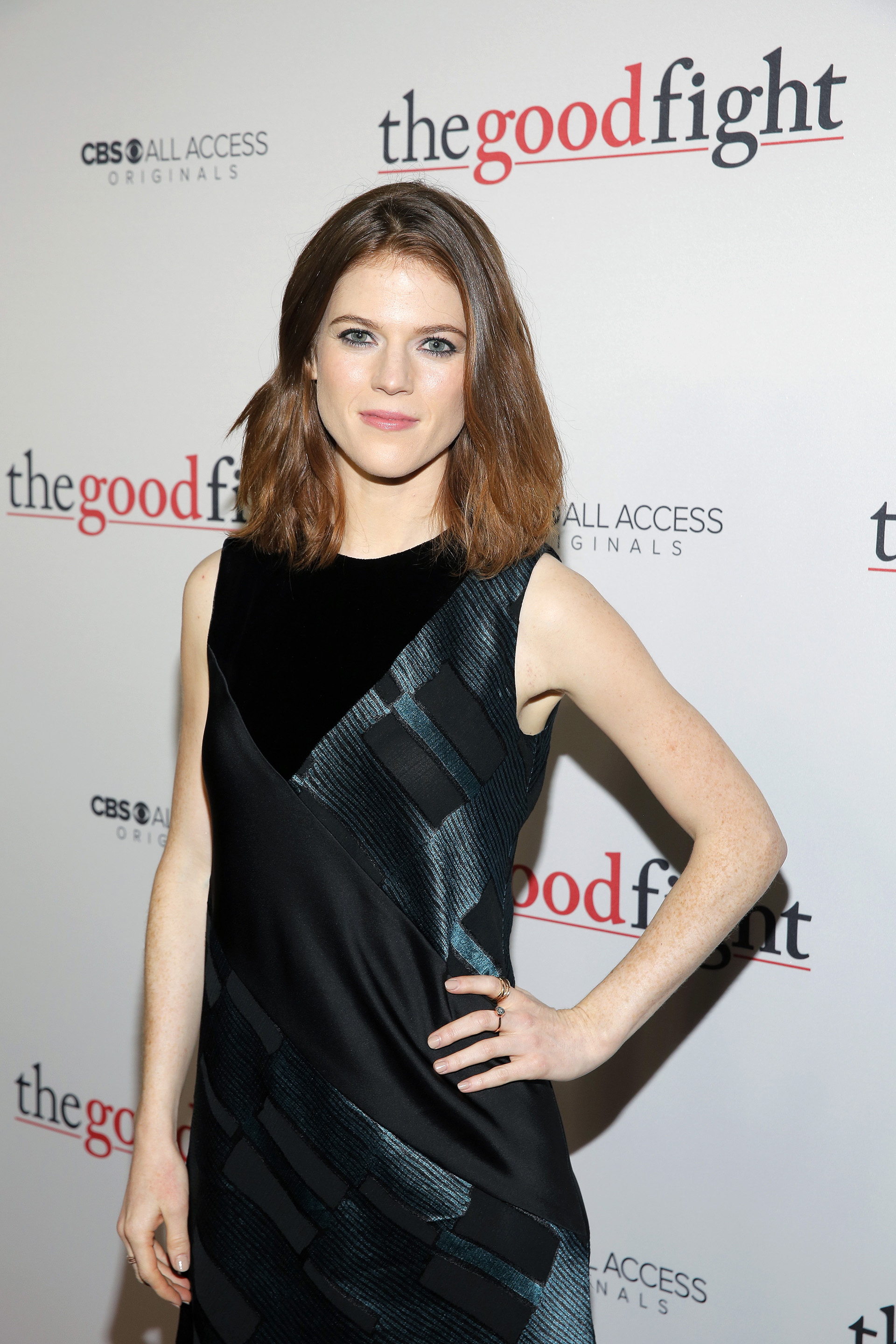 Rose Leslie is stunning in a dark turquoise and black velvet sheath.