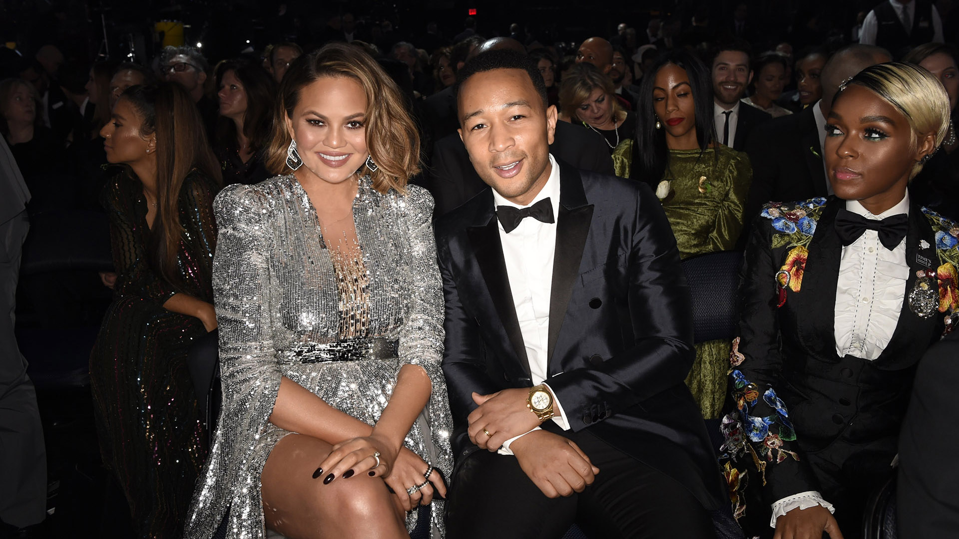 Soul-pop crooner John Legend offers a smile for the camera alongside wife Chrissy Teigen, while Janelle Monáe looks on.