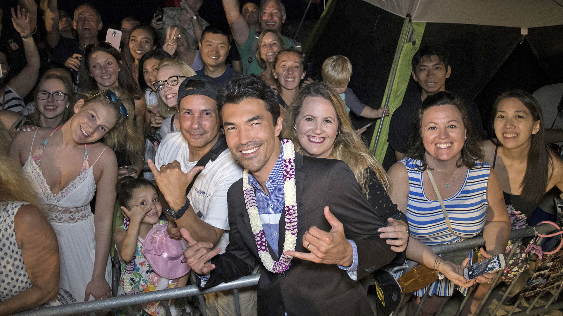 Ian Anthony Dale hangs ten with a bevy of fans.