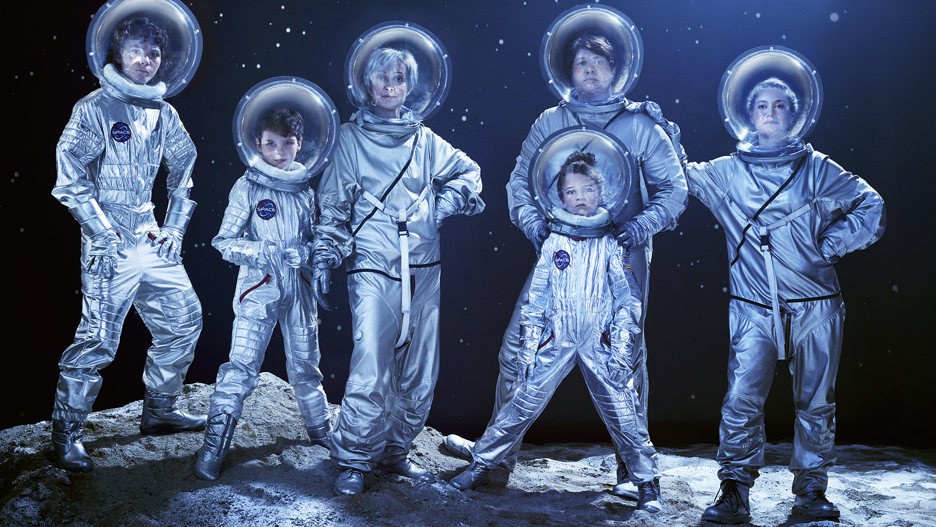 The cast of Young Sheldon as American astronauts