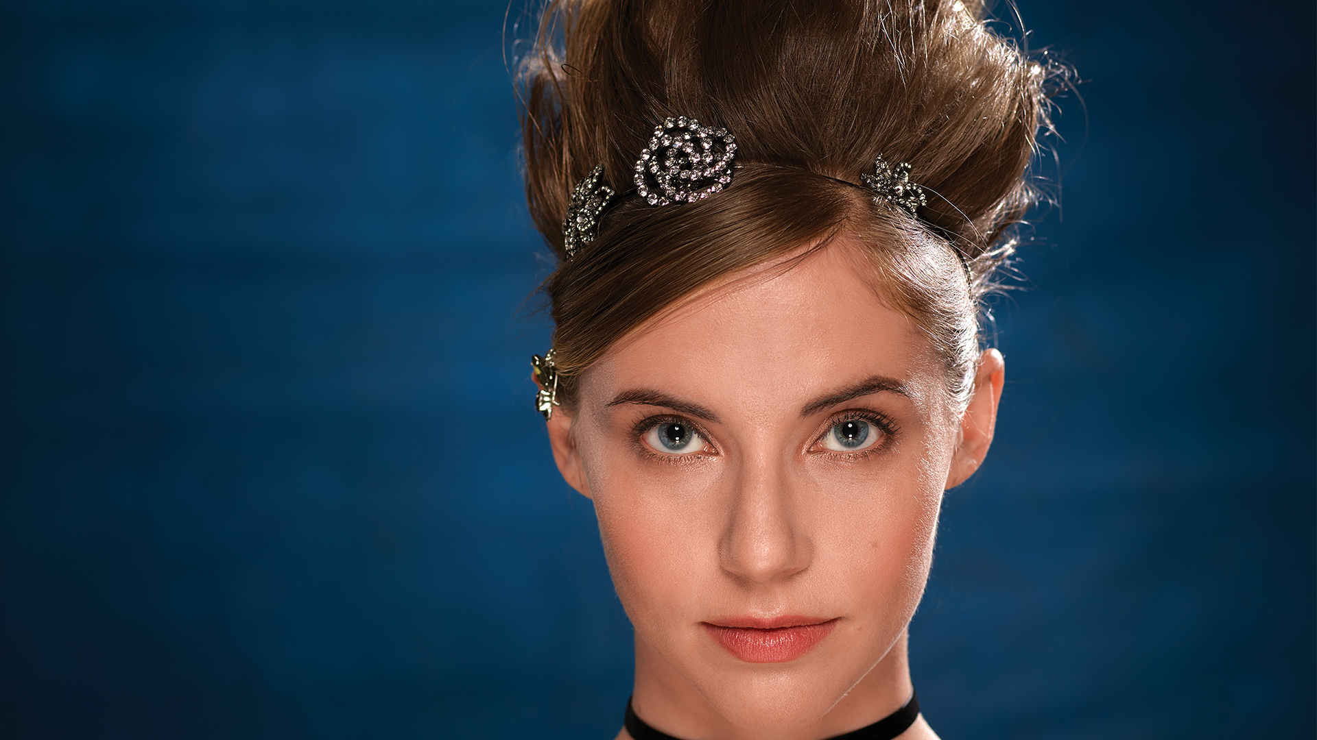 Wallis Currie-Wood adds festive sparkle and head bling to her hairstyle