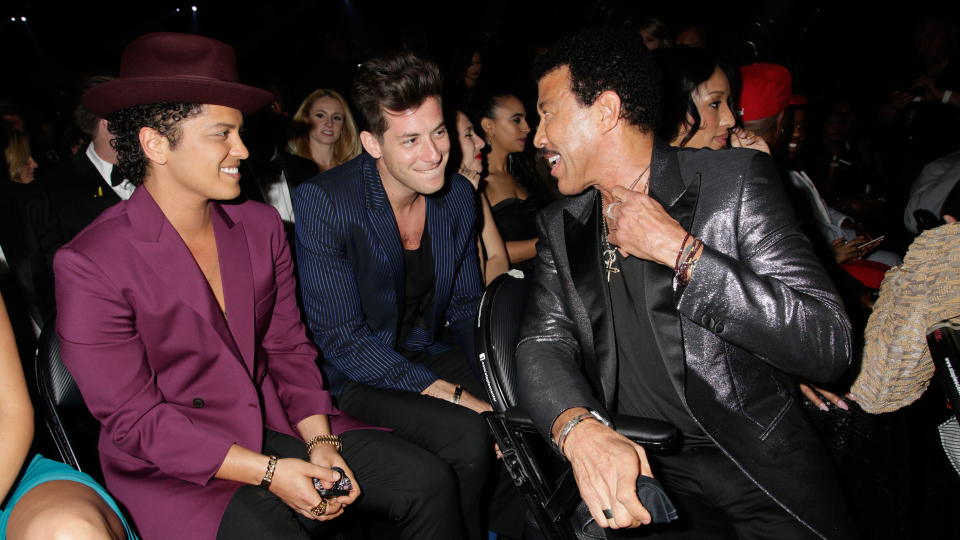 Bruno Mars, Mark Ronson, and Lionel Richie share some laughs in the audience