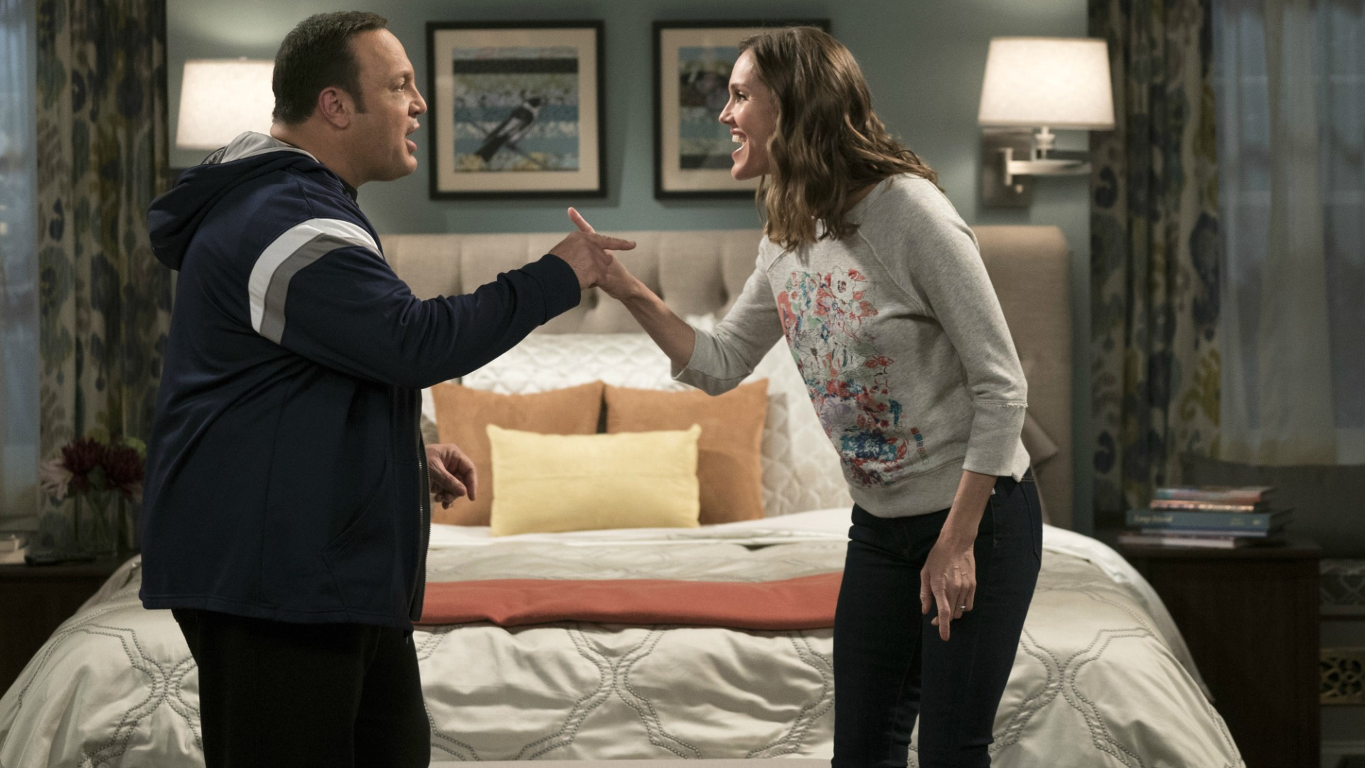 Kevin and Donna discuss the situation in their bedroom.