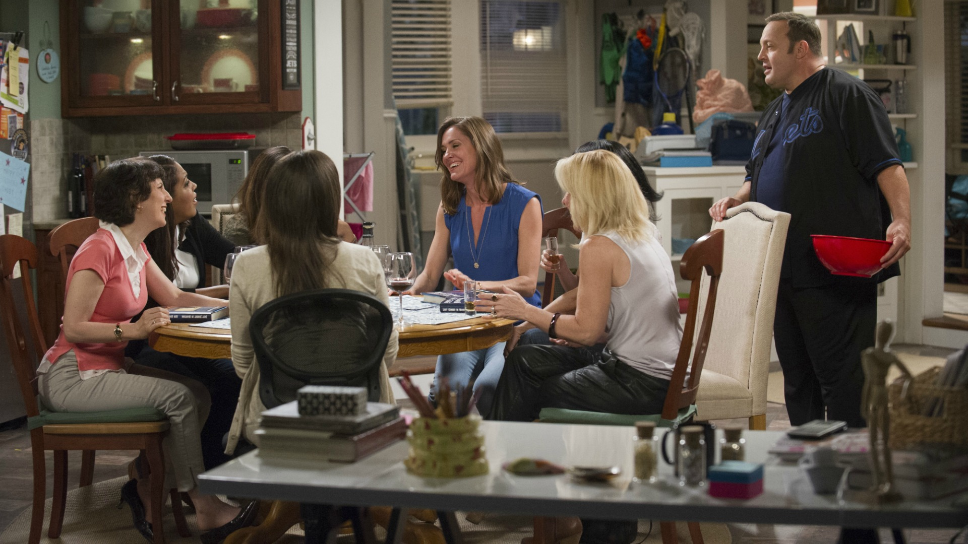 Kevin walks in on Donna's book club after hearing the ladies' laughter.