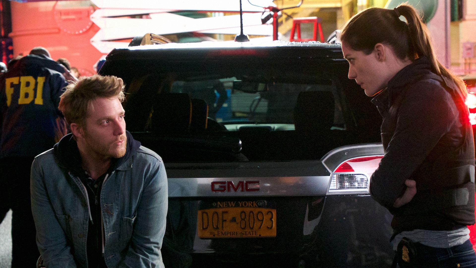 Rebecca questions Brian on the scene.