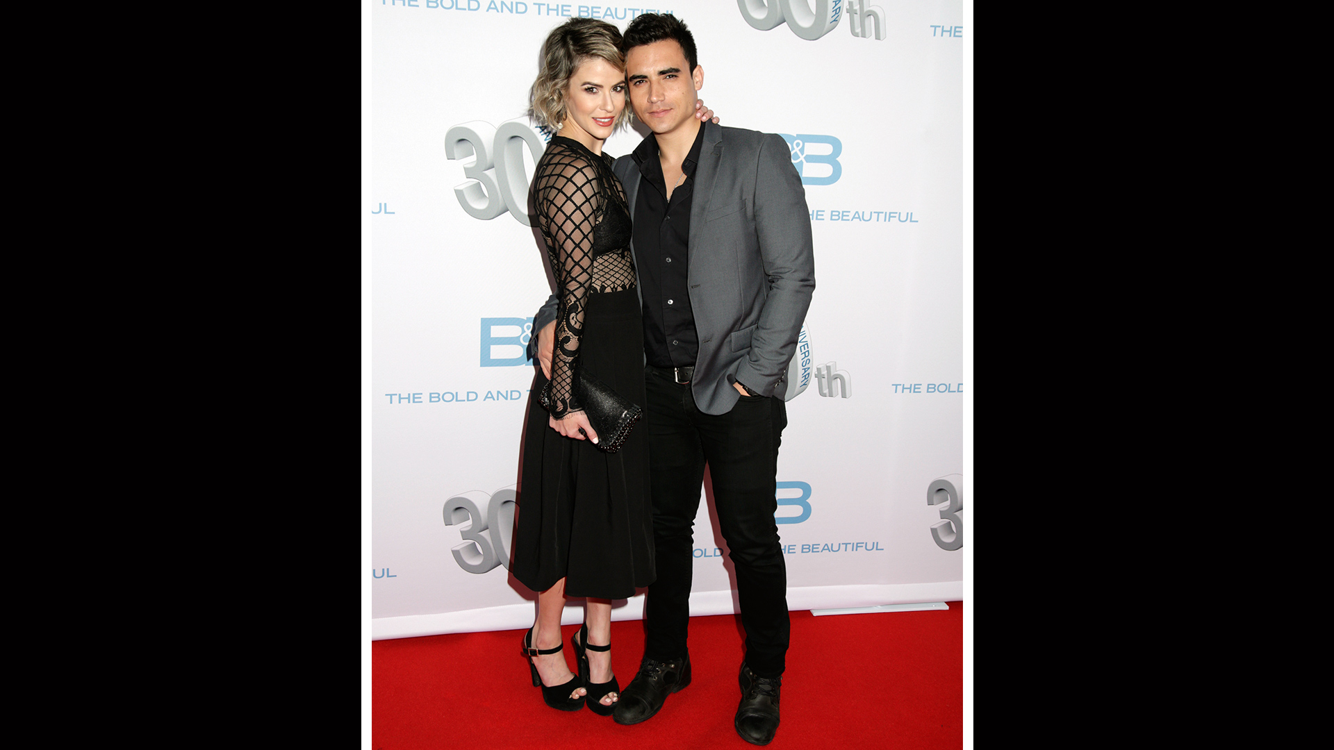 Linsey Godfrey shows some skin and poses with her date, Marco James Marquez.