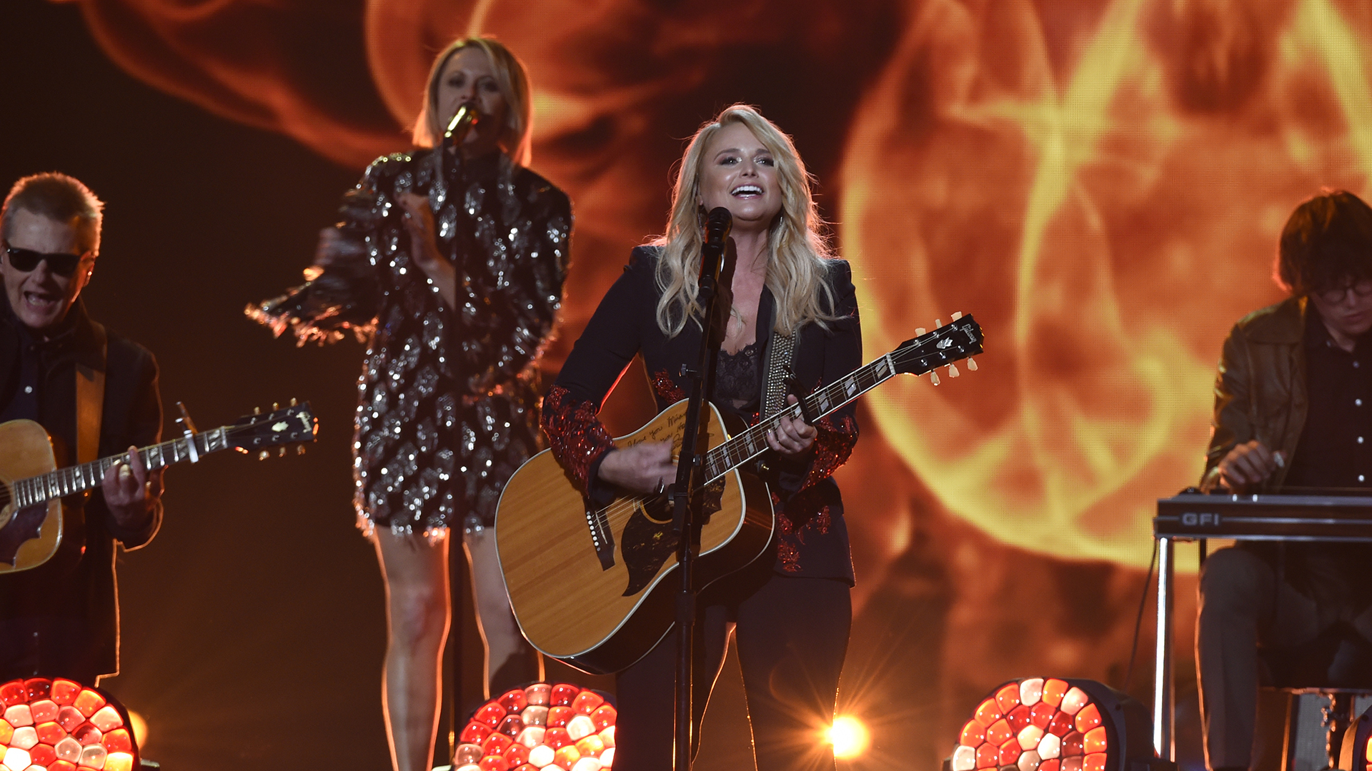 Decked out in a blazer and bustier, Song of the Year winner (and now ACM wins record holder!) Miranda Lambert strums the guitar for