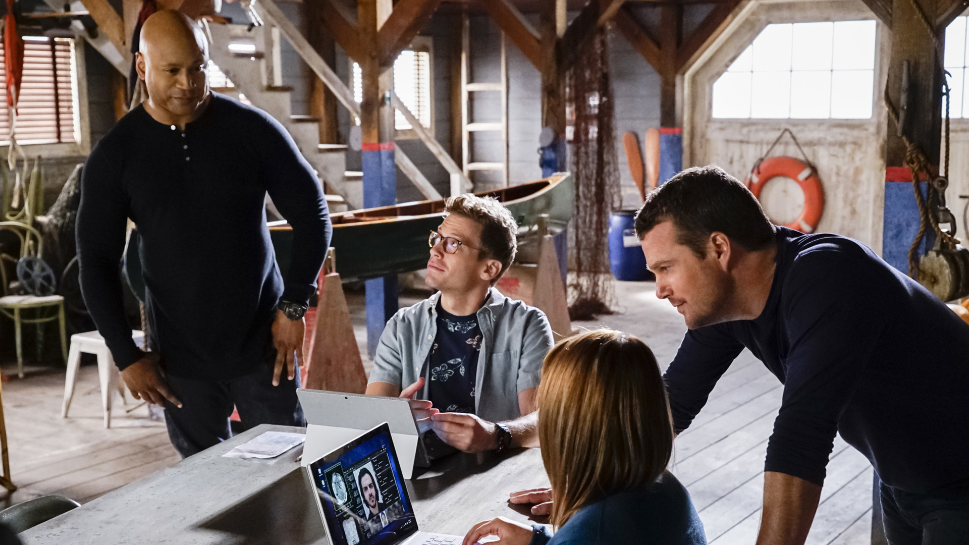 Sam and Callen consult with Eric and Nell.