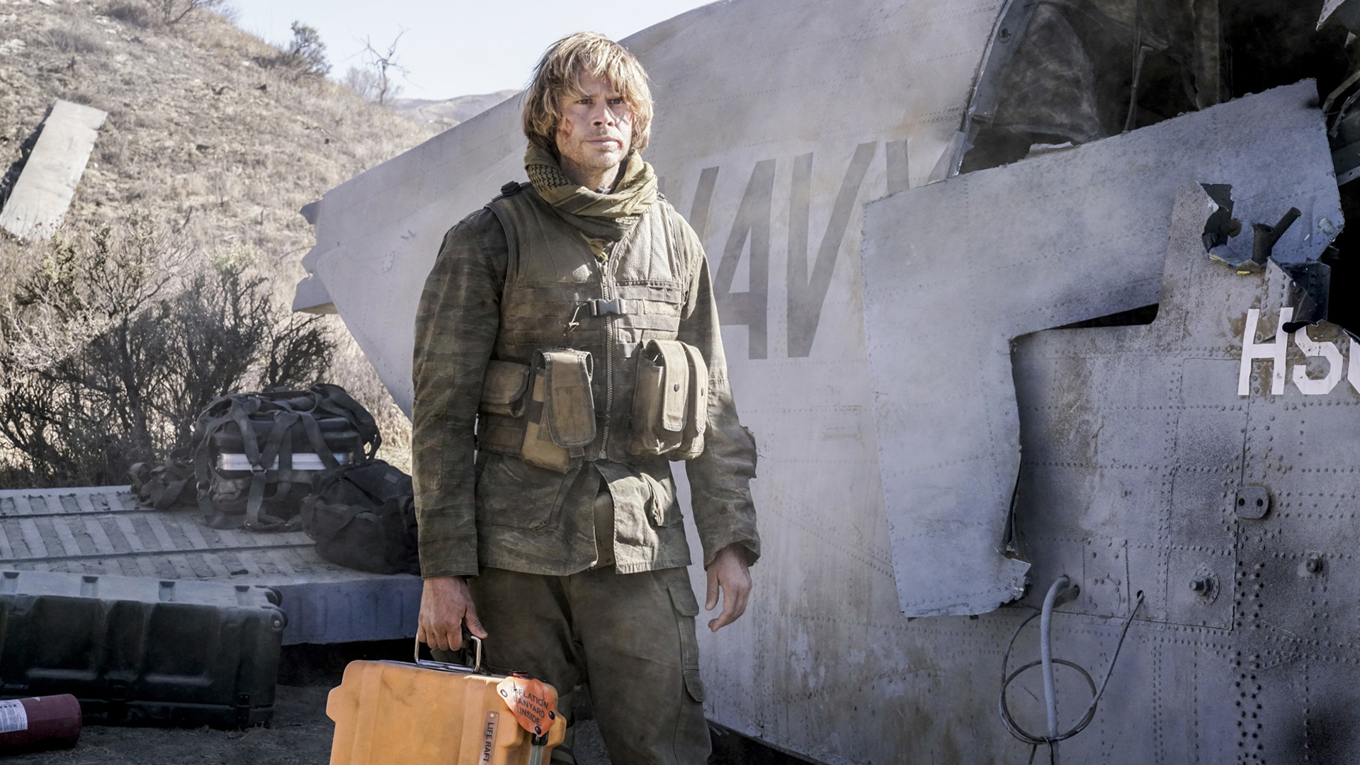 Deeks grabs some gear to get out of danger.