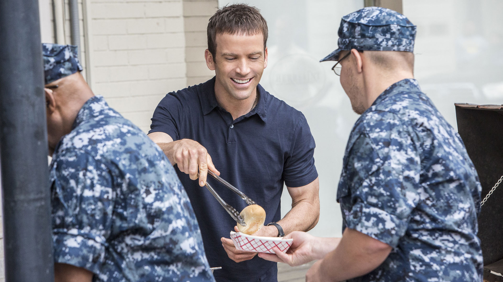 Lasalle serves food to military personnel.