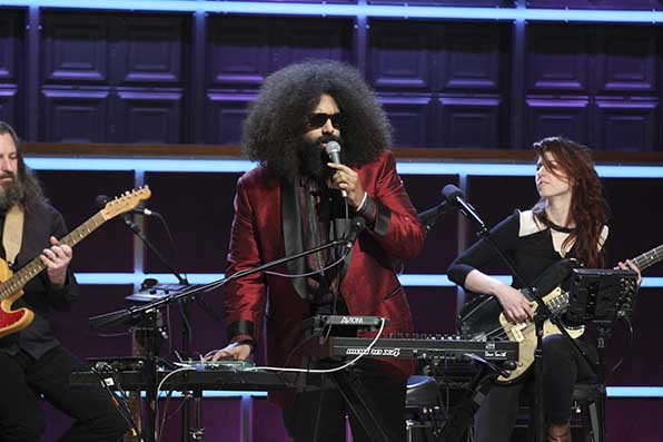 Reggie Watts plays us in.