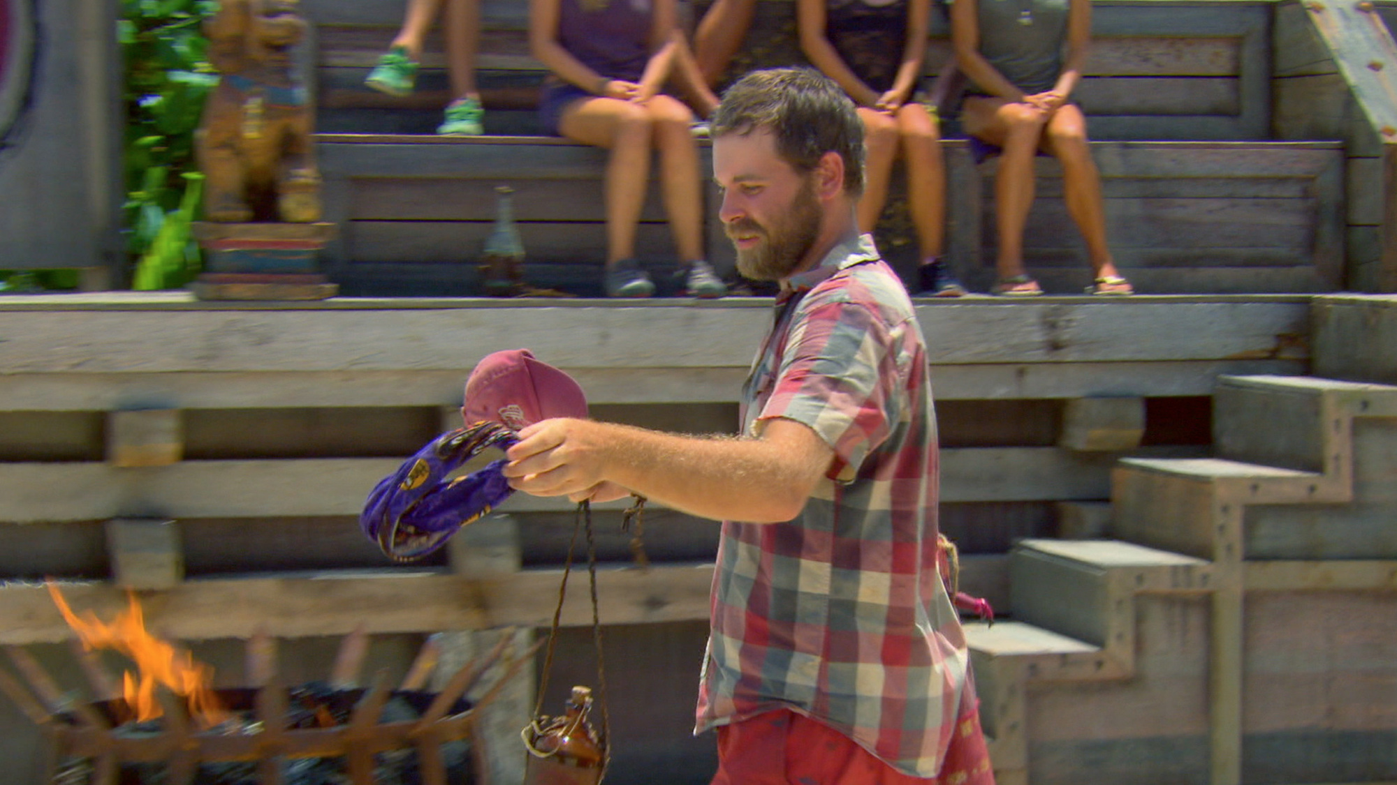 Caleb tosses his buff in the fire in Season 27 Episode 12