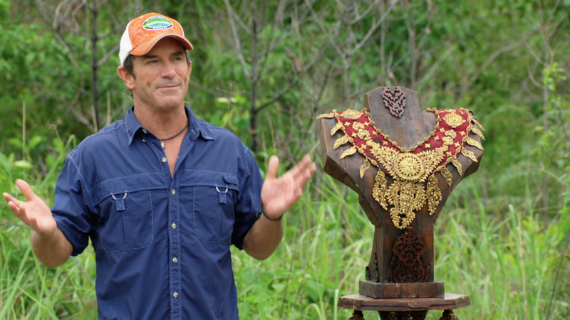 Jeff stands beside the impressive Immunity necklace that's up for grabs.