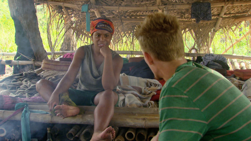 Tasha and Spencer talk strategy back at camp.