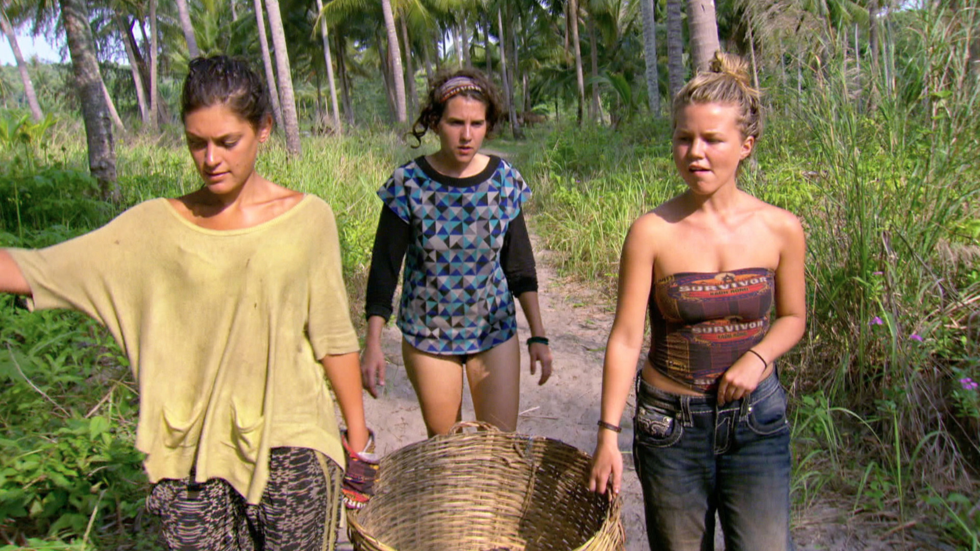 Michele, Aubry, and Julia tend to their duties around camp.