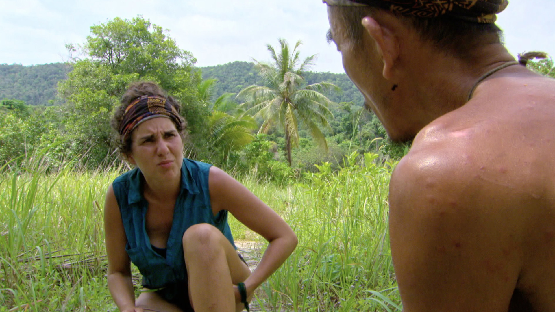 Aubry and Tai get some distance from camp to discuss strategy.