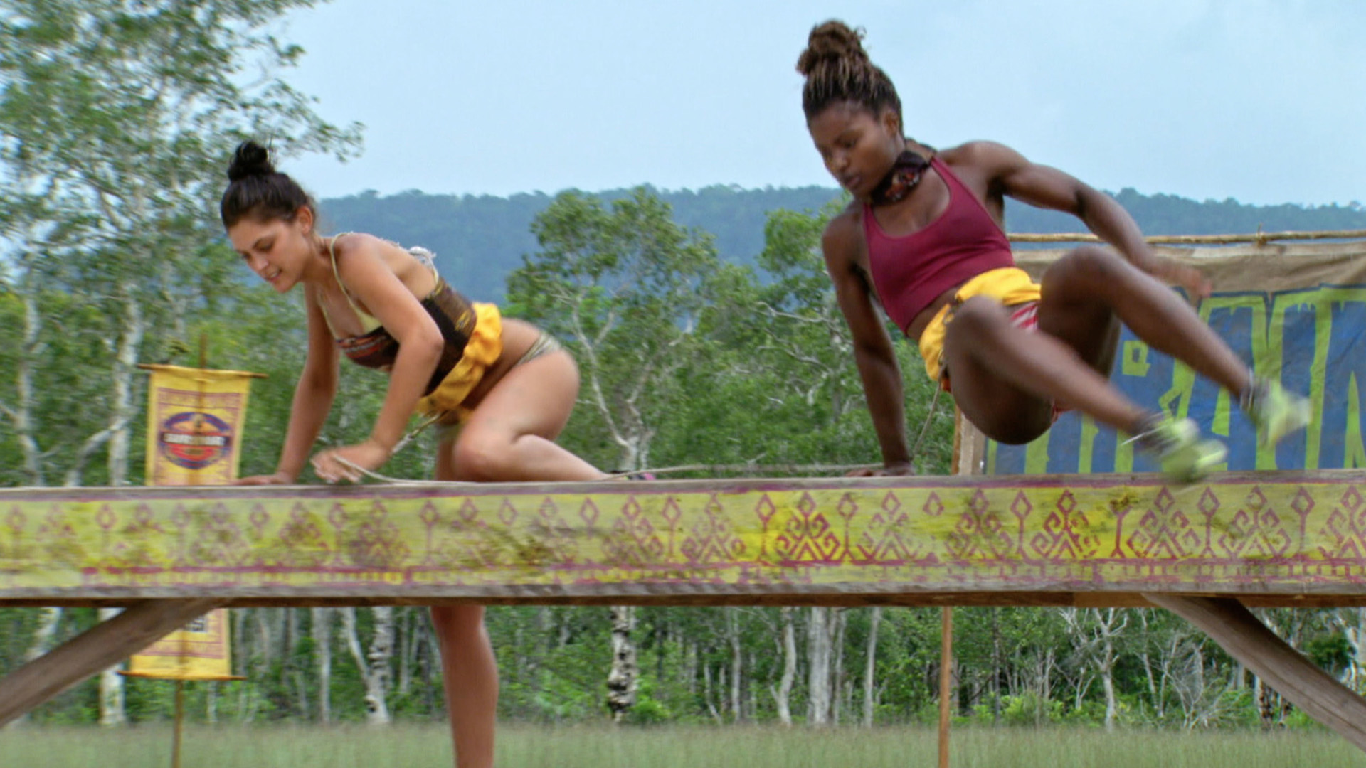 Michele and Cydney take on the Reward Challenge tethered together.
