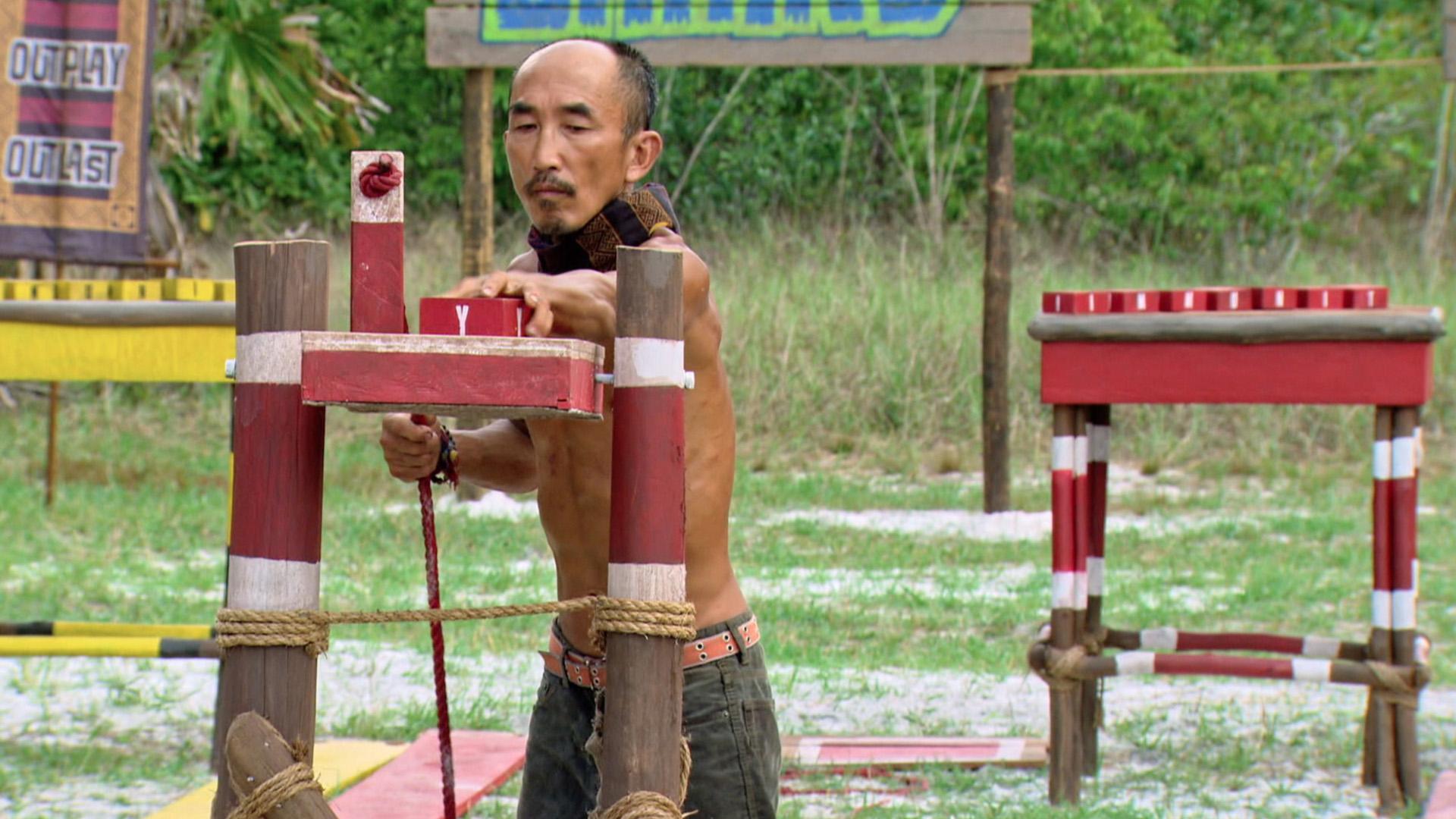 Tai restacks his blocks during the Individual Immunity Challenge.