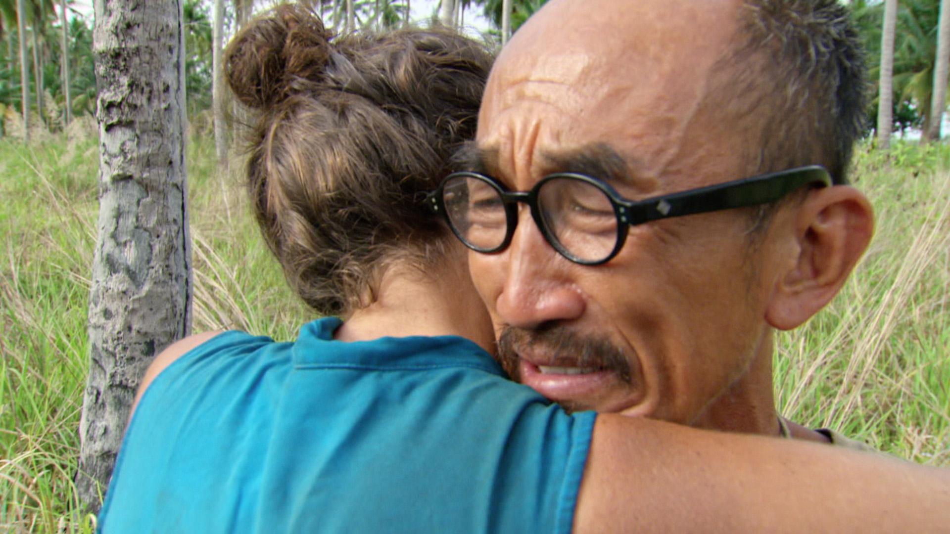 Tai and Aubry share a warm embrace.