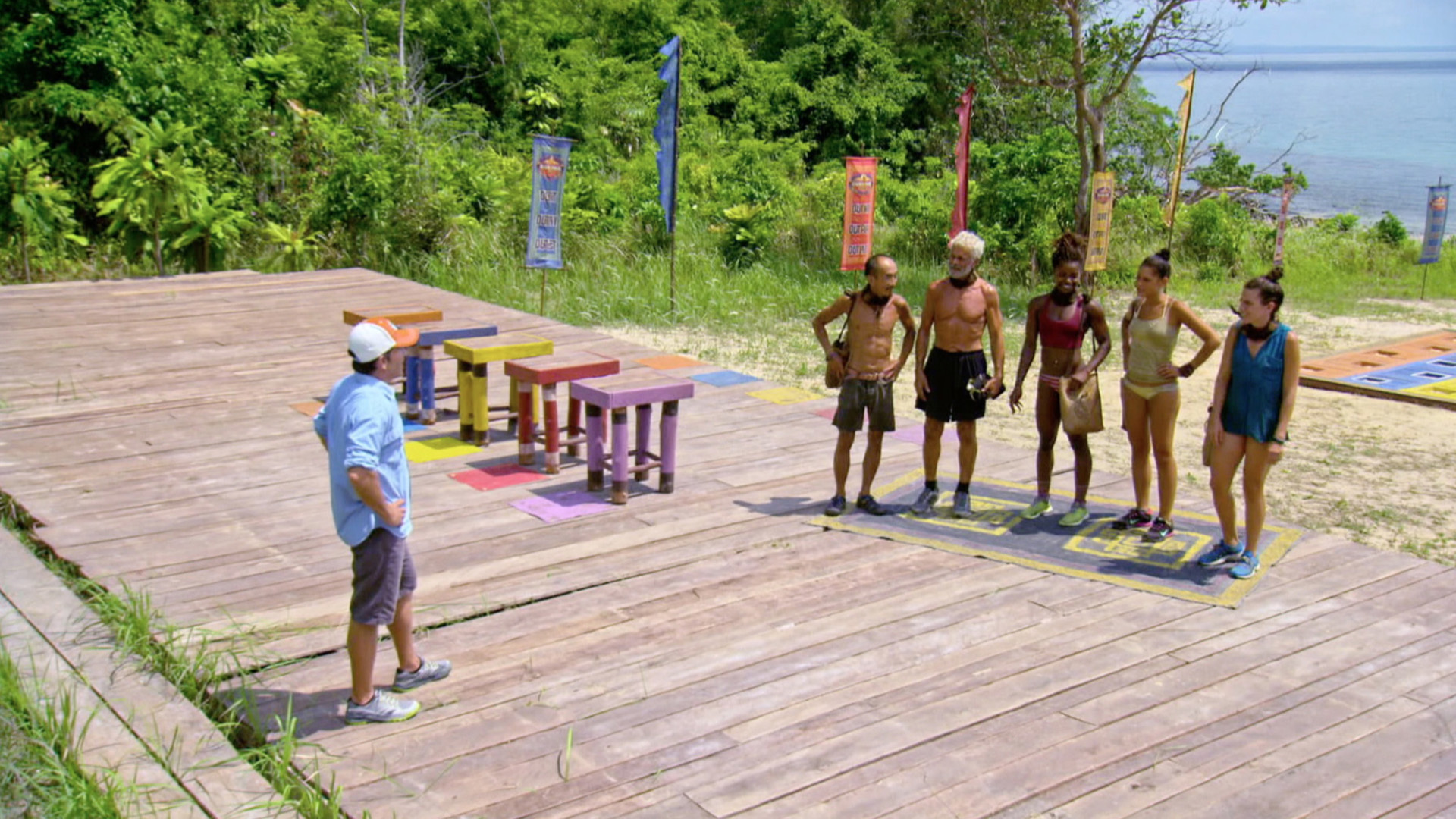 Host Jeff Probst instructs the Final 5 on how the Reward Challenge will work.