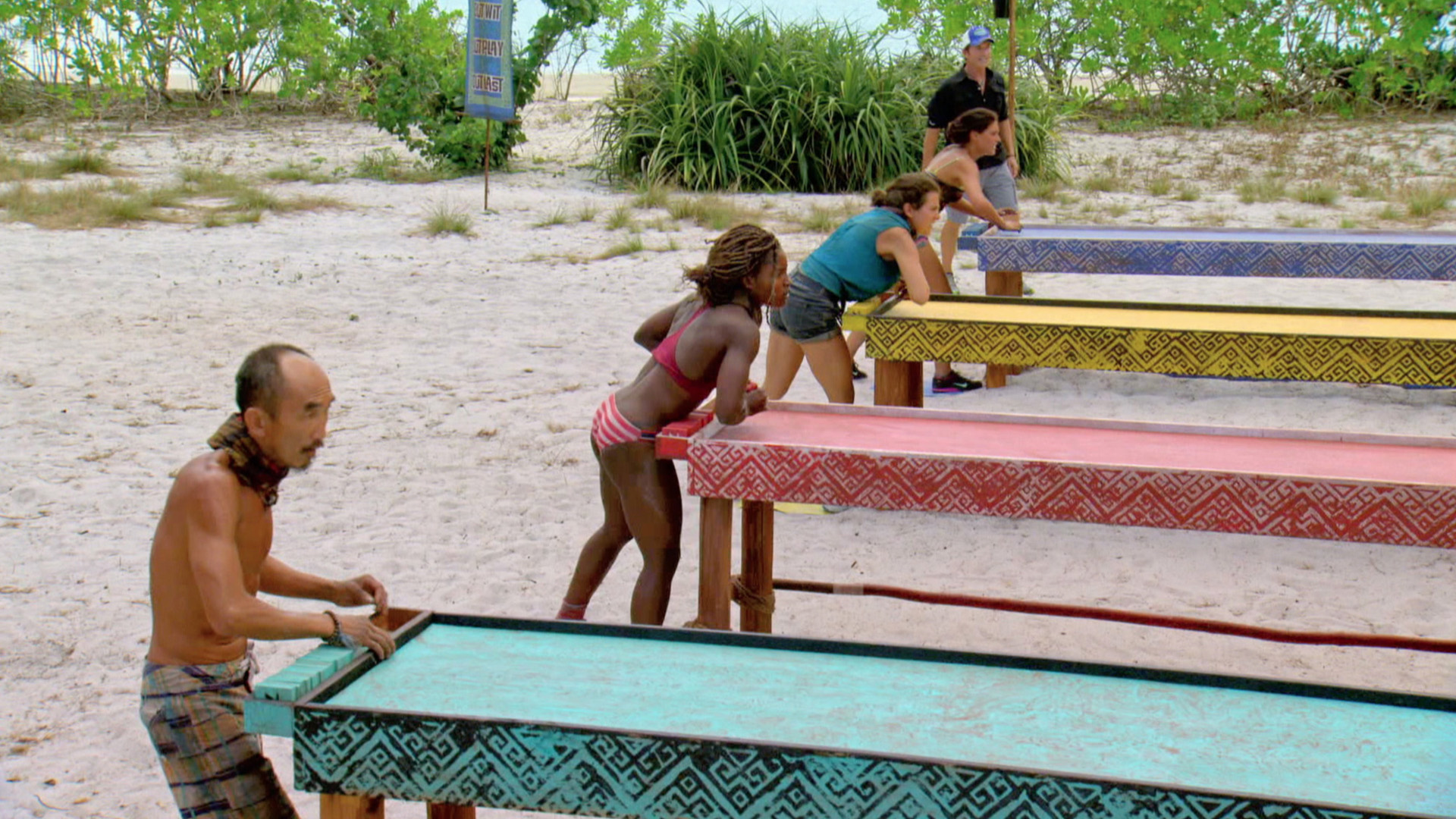The castaways are tasked with sliding tiles into a target.