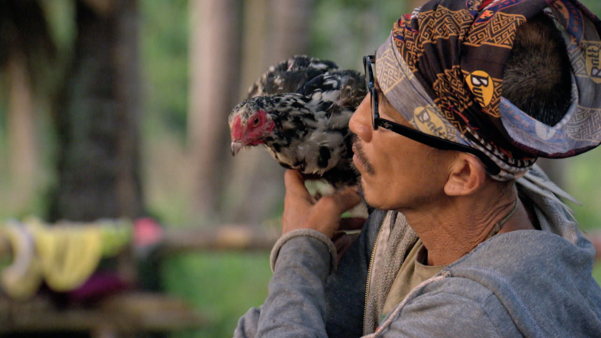 Tai takes a private moment with his beloved chicken.