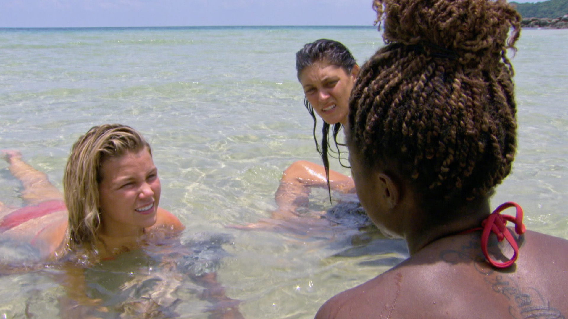 Julia, Michele, and Cydney have a girls-only chat in the ocean.