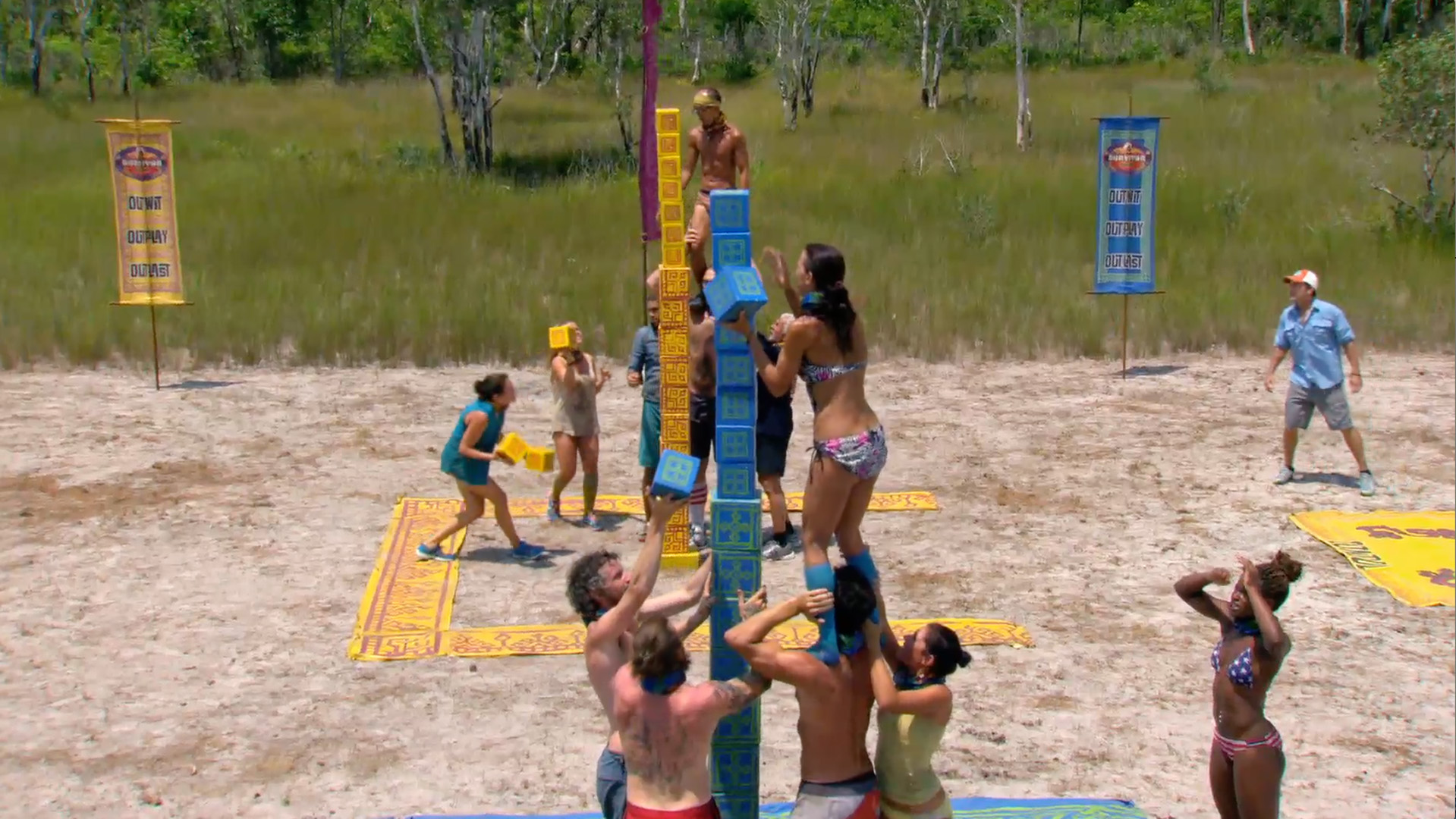 6. Tai and Debbie climb to great heights in the Immunity Challenge.