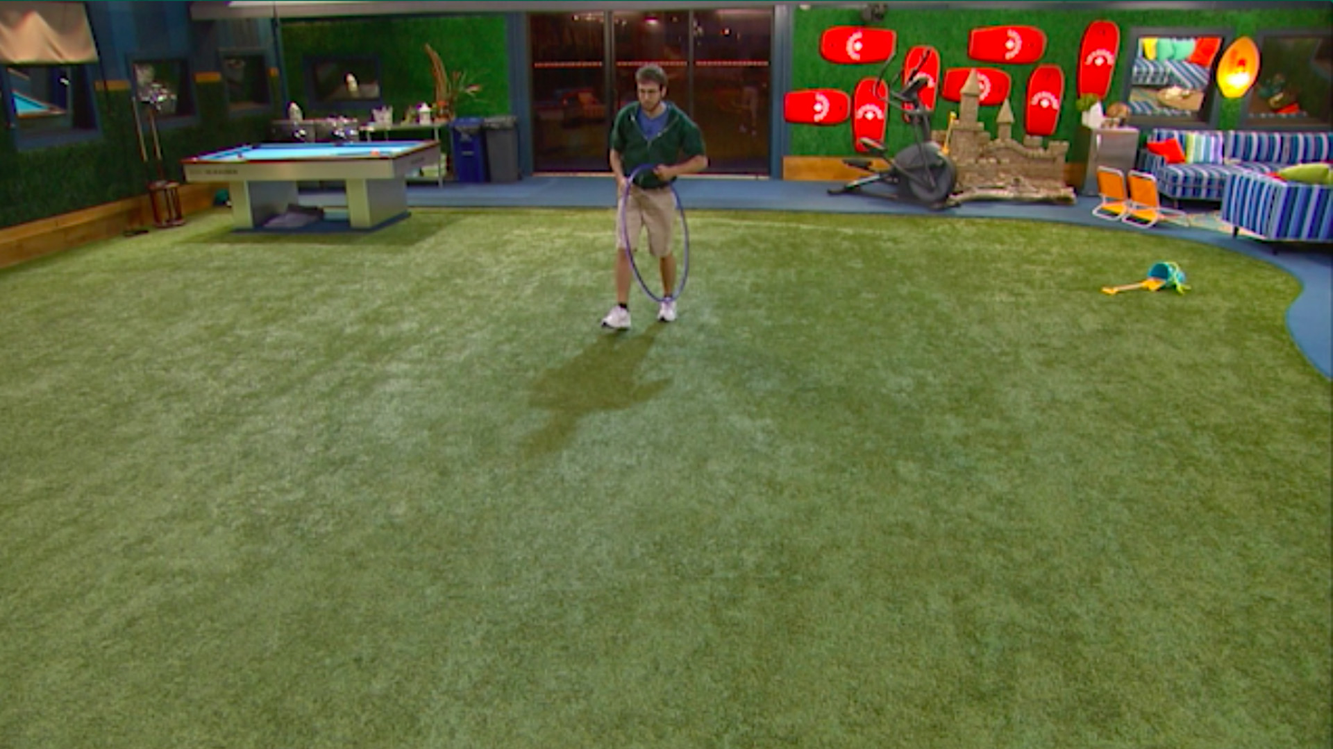 7. Steve plays with a hula hoop alone in the backyard.