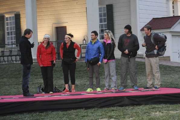 """Phil Keoghan greets the final three teams in the season finale of The Amazing Race """"Beacon of Hope"""""""