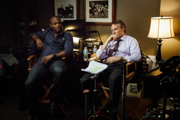 Billy Brown and Tate Donovan hang out on the set