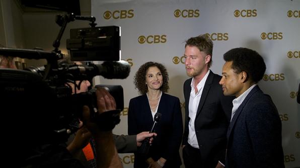 Mary Elizabeth Mastrantonio, Jake McDorman, and Hill Harper on the red carpet.