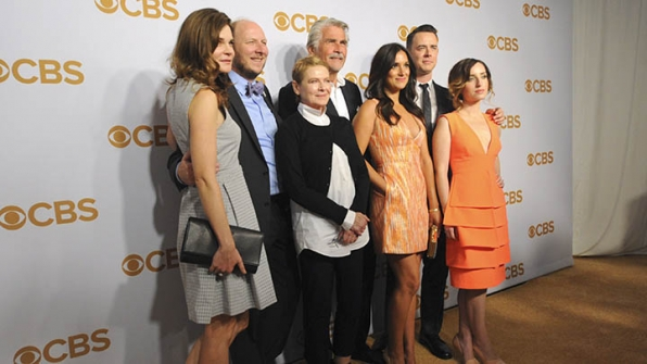 The cast of Life in Pieces fit together perfectly on the gold carpet.