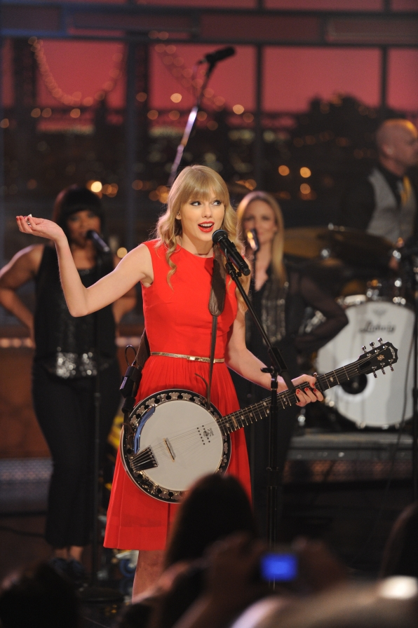 Taylor Swift Performs with Her Band