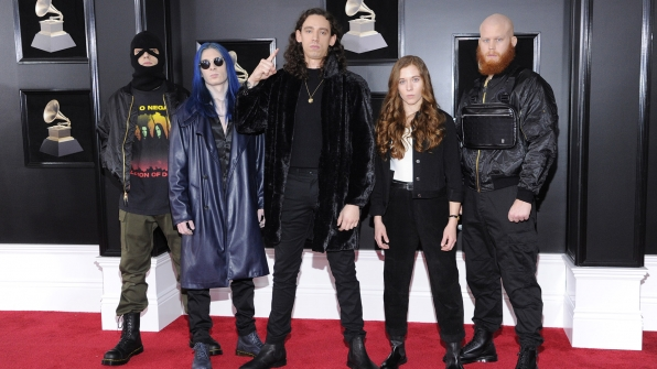 Code Orange, nominated for Best Metal Performance, make a colorful appearance on the red carpet.