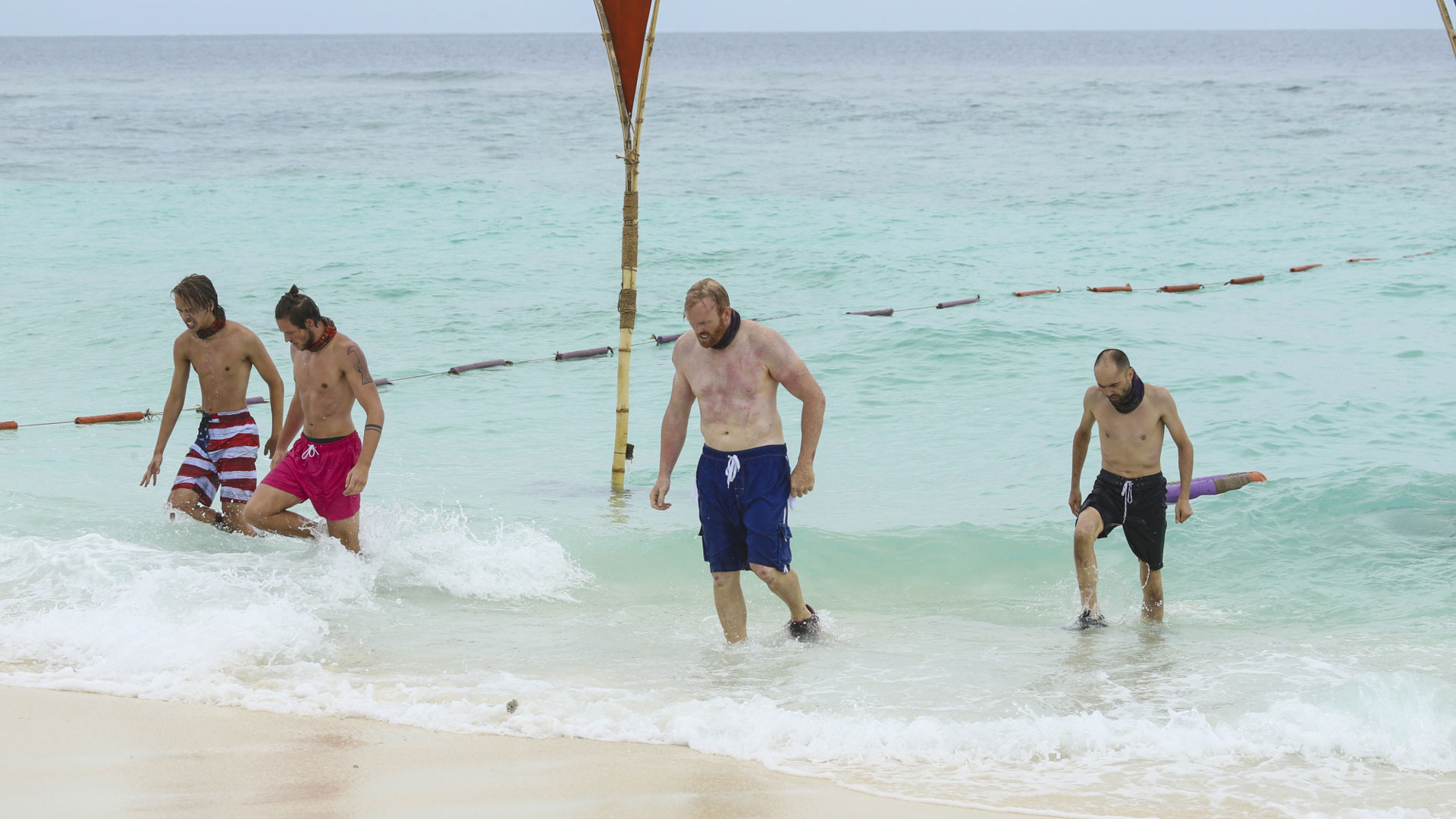 Will, Taylor, Chris, and David walk back to shore.