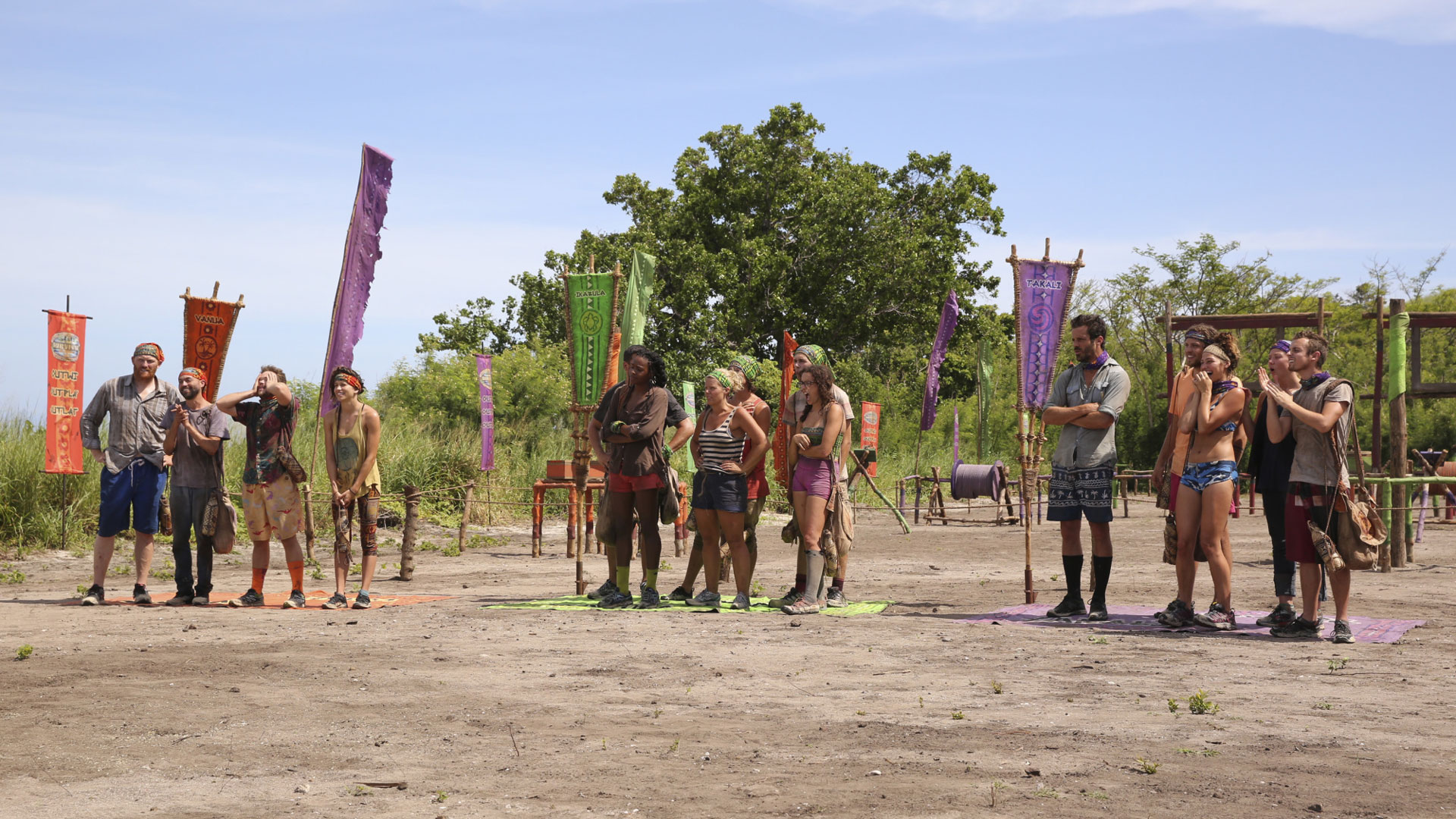 The three tribes hear instructions before getting started.