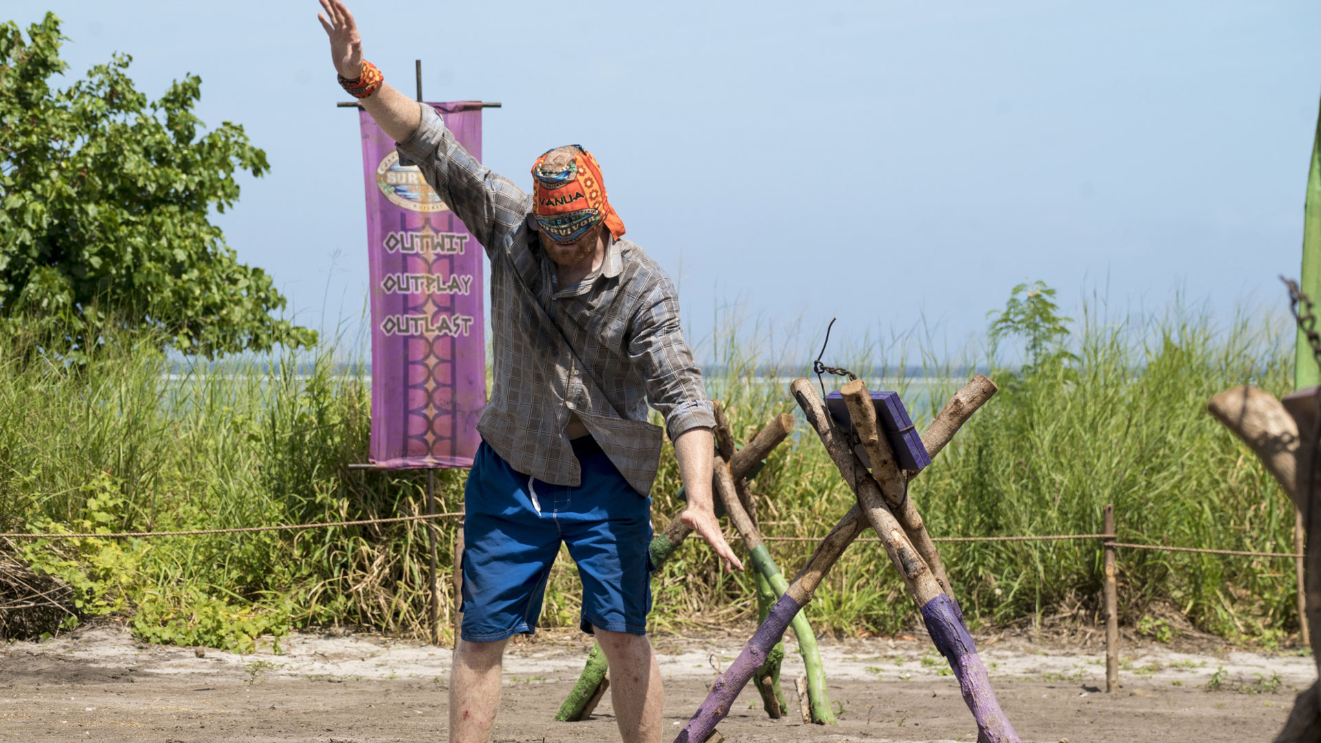 Chris throws a hand up, hoping to find his balance and his way around the obstacle course.