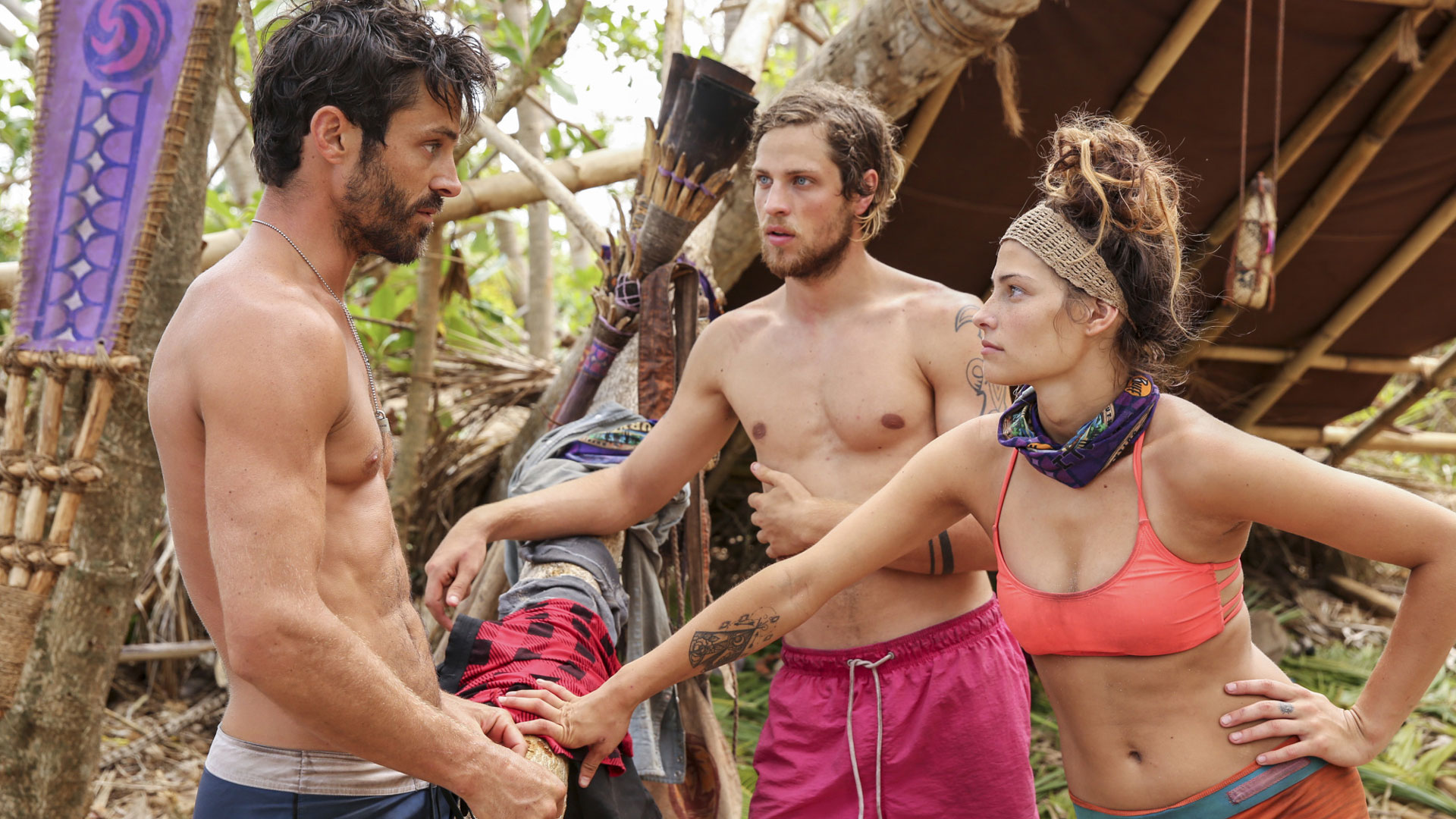 Takali tribe members Ken, Taylor, and Figgy have a conversation.