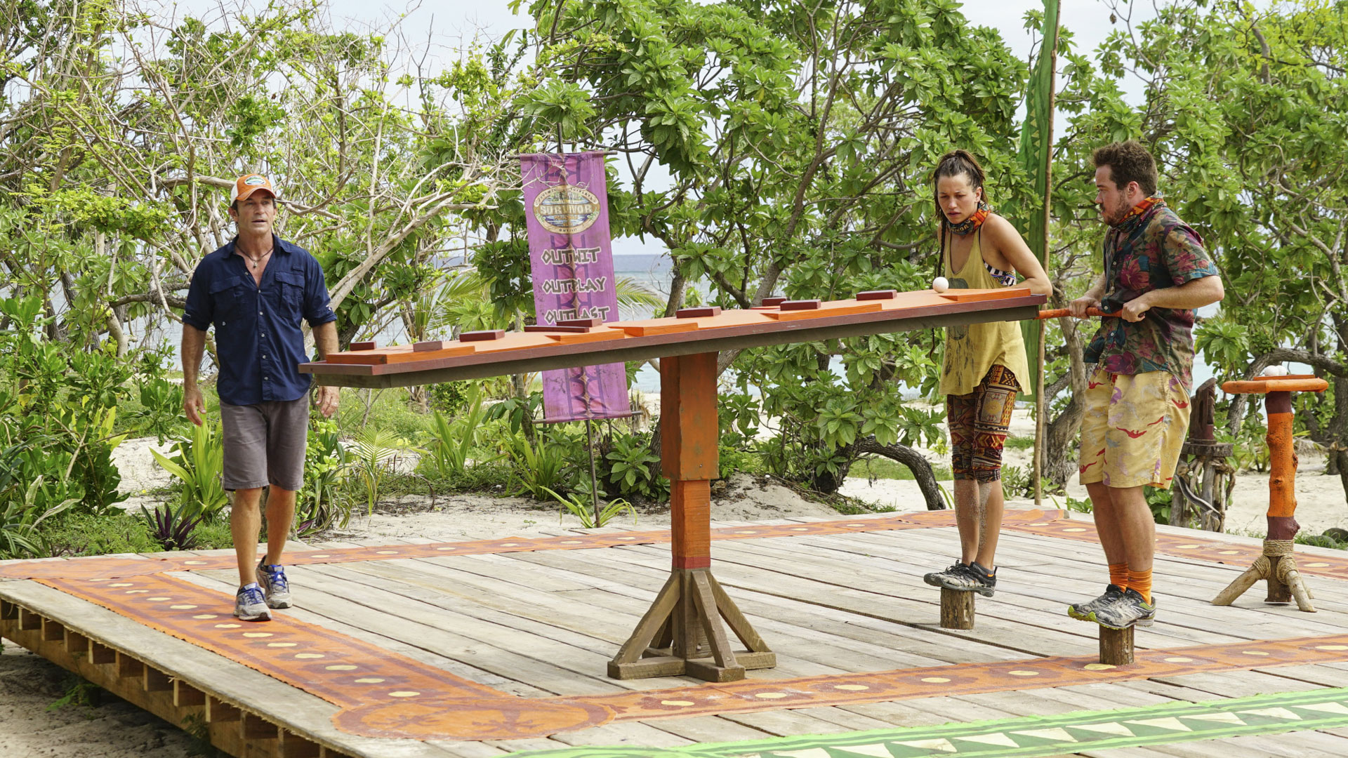 Jeff watches as Michelle and Zeke try their best at the final part of the challenge.