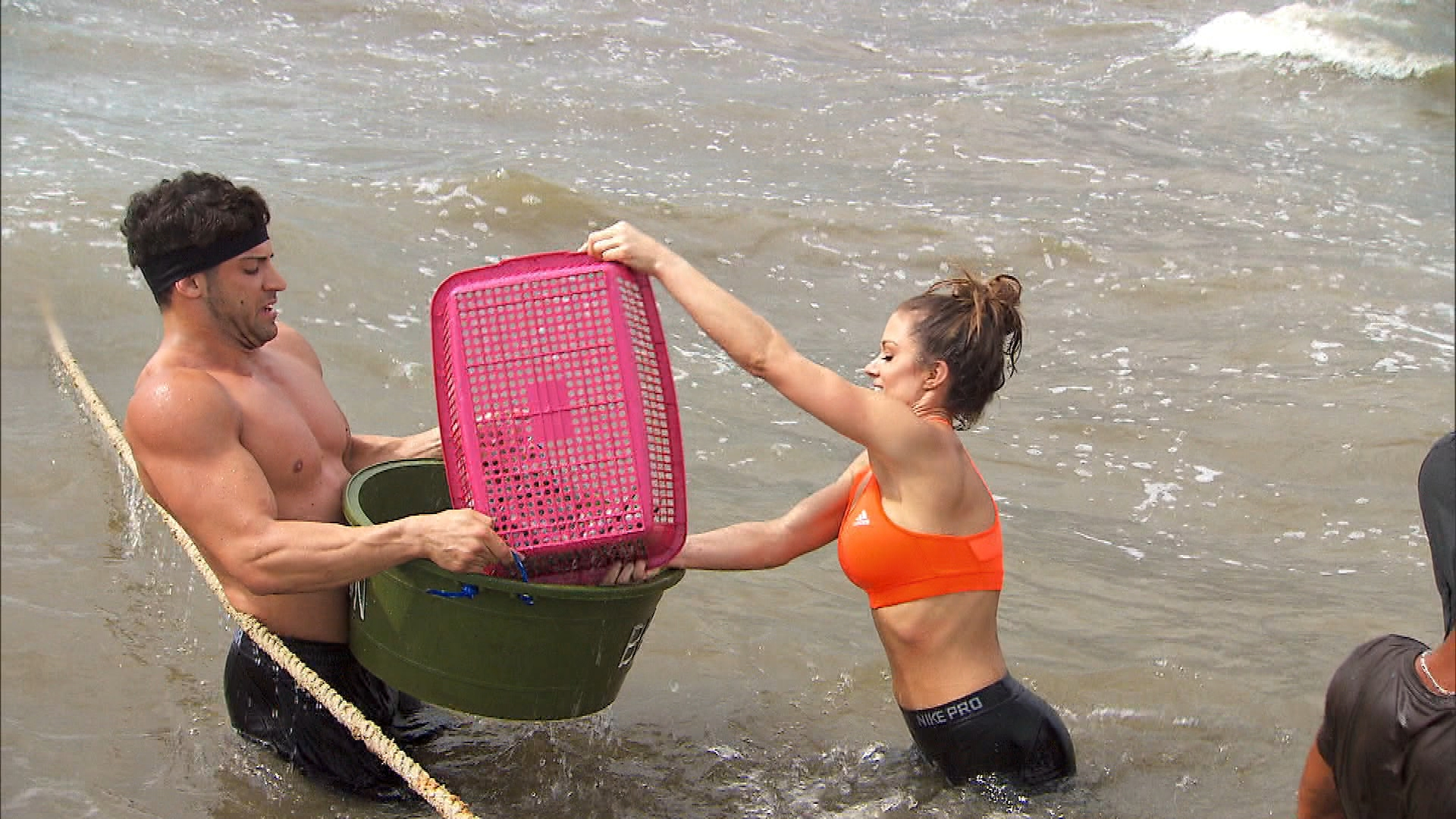 Carrying buckets of fish