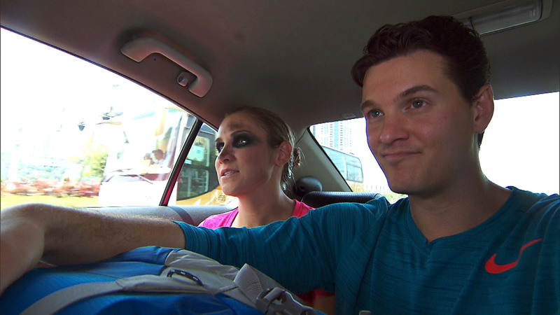 After completing the Roadblock, Kelsey and Joey make their way to the Pit Stop at Nam Van Lake Pier.