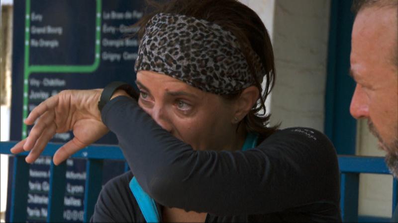 Logan (#ThePaparazzi) wipes her tears en route to Paris