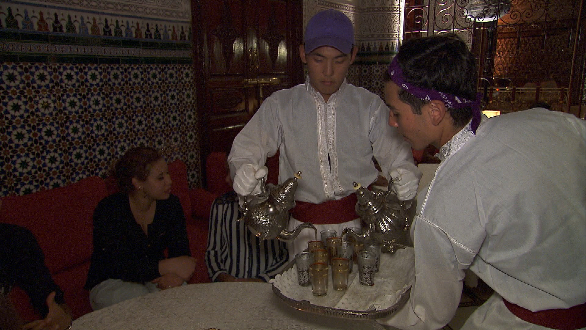 Pouring tea for customers