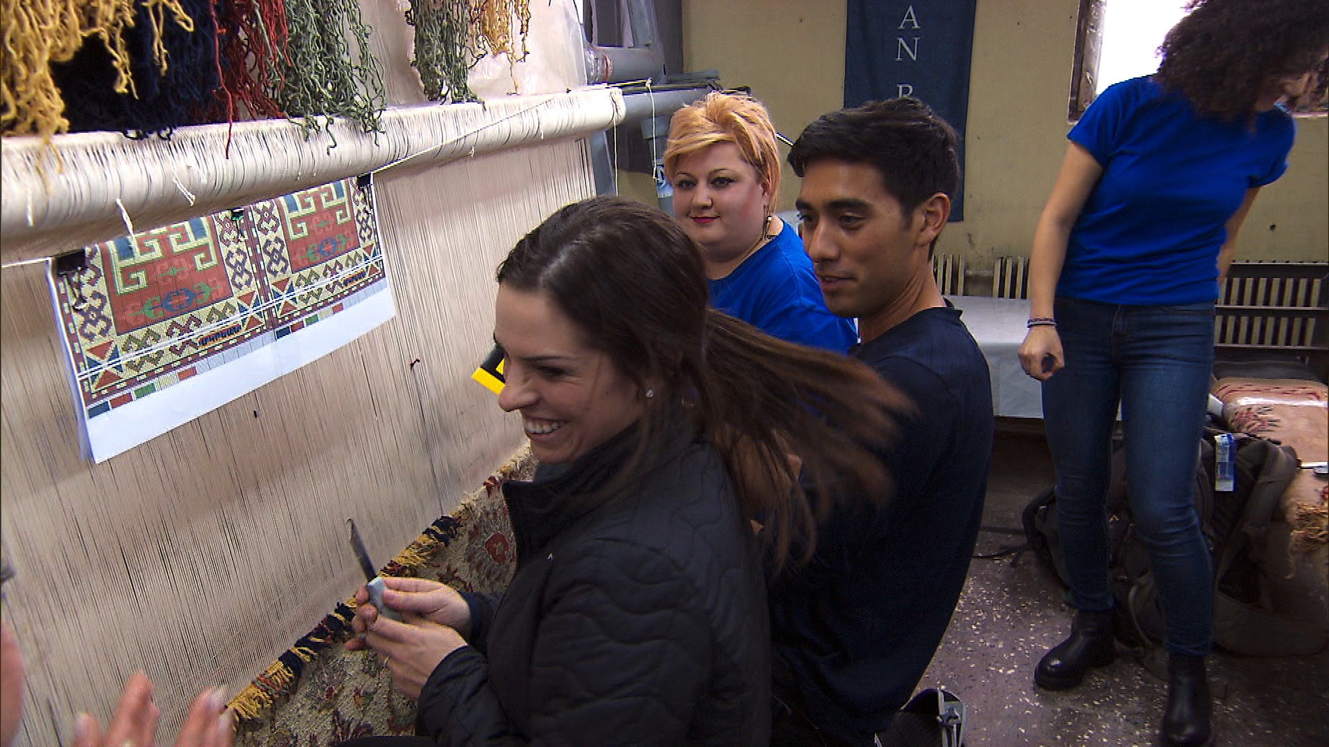 In Detour A, Rachel and Zach try to correctly weave a marked section of carpet.