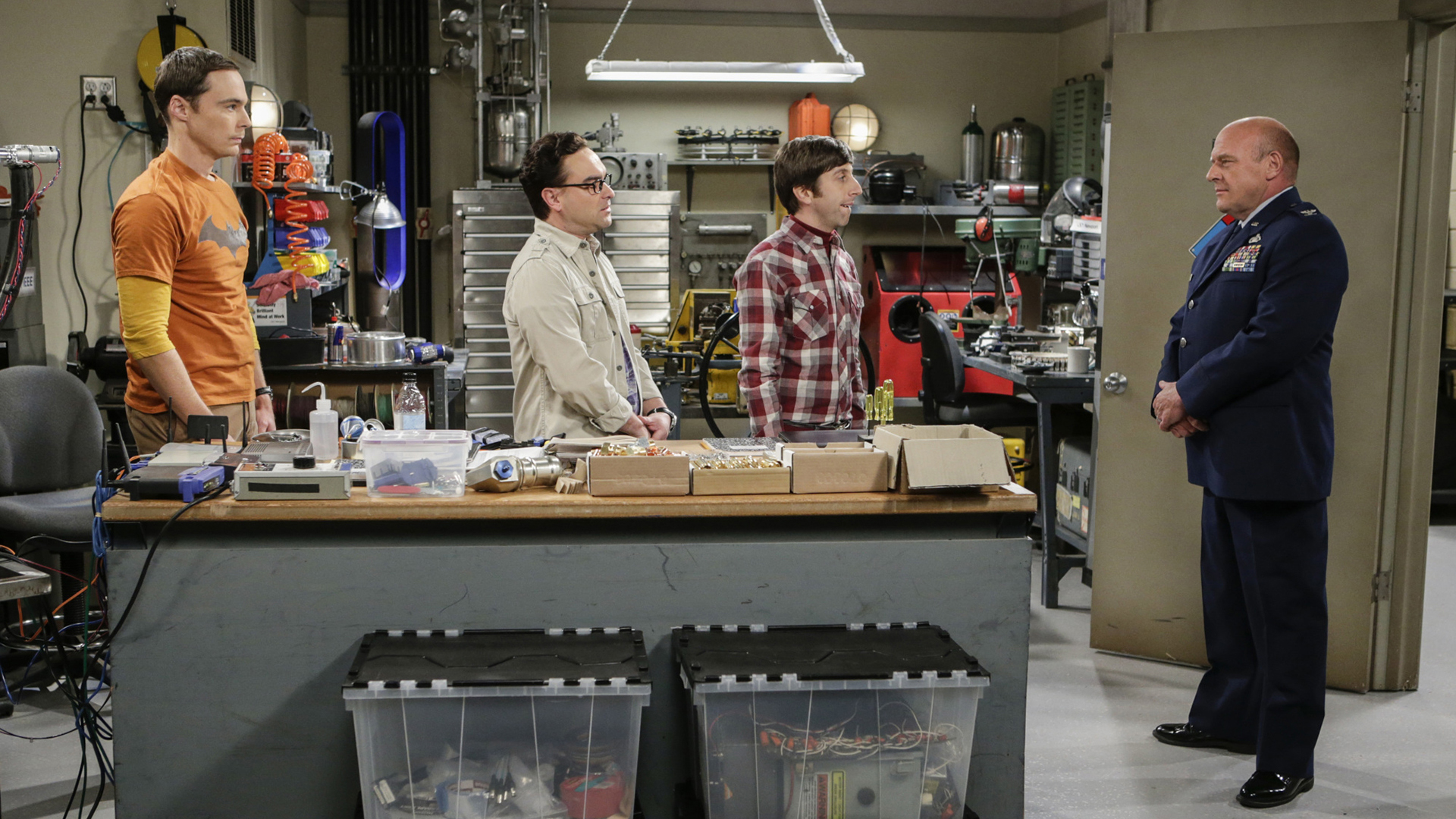 Sheldon, Leonard, and Howard try to keep their cool in front of the colonel.