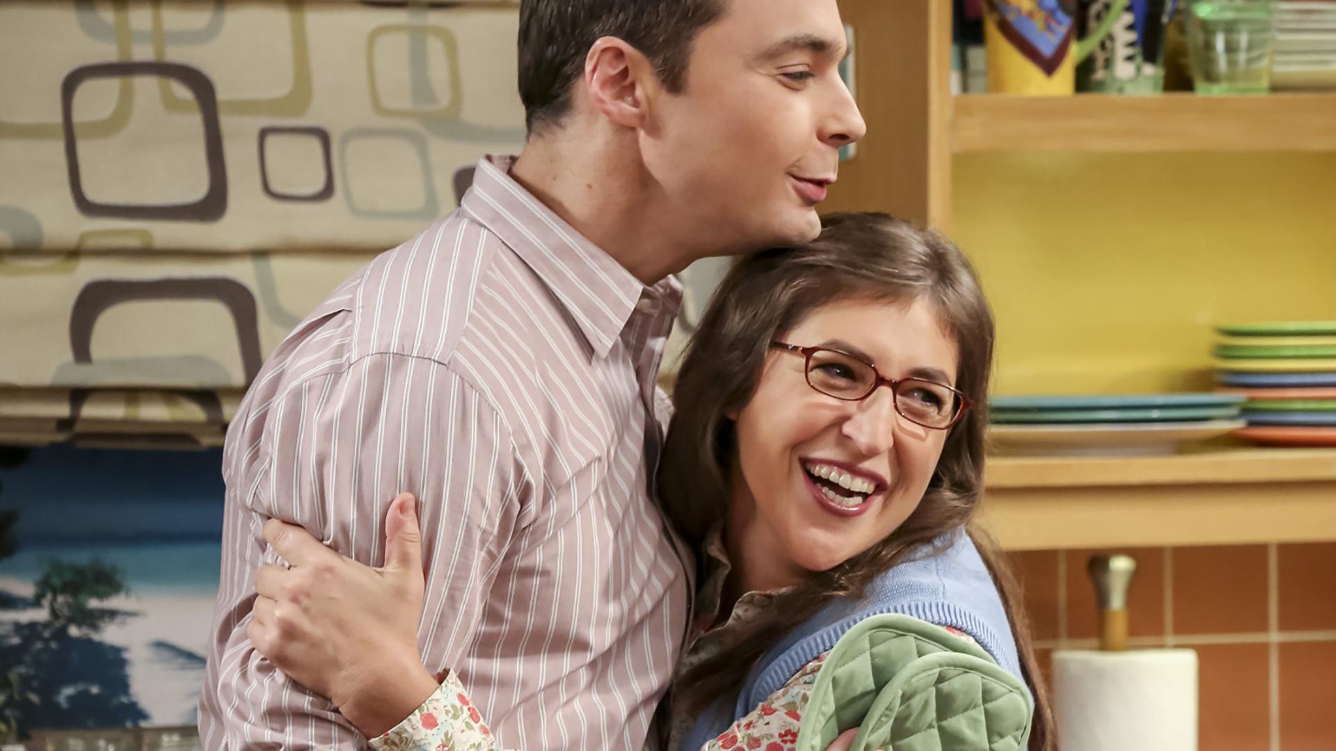 Sheldon and Amy share a hug.